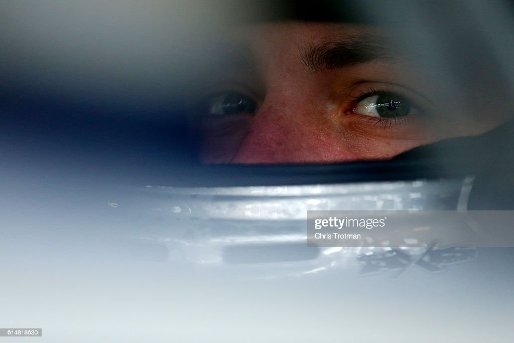 Alex Bowman, driver of the #88 Nationwide Chevrolet, sits in his car during practice for the NASCAR Sprint Cup Series Hollywood Casino 400 at Kansas Speedway on October 15, 2016 in Kansas City, Kansas.