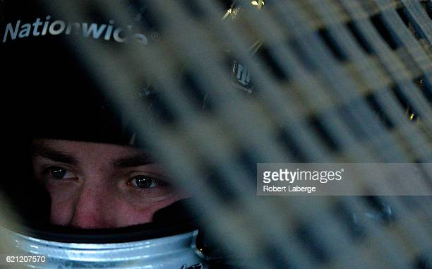 Alex Bowman driver of the Nationwide Chevrolet sits in his car during practice for the NASCAR Sprint Cup Series AAA Texas 500 at Texas Motor Speedway...