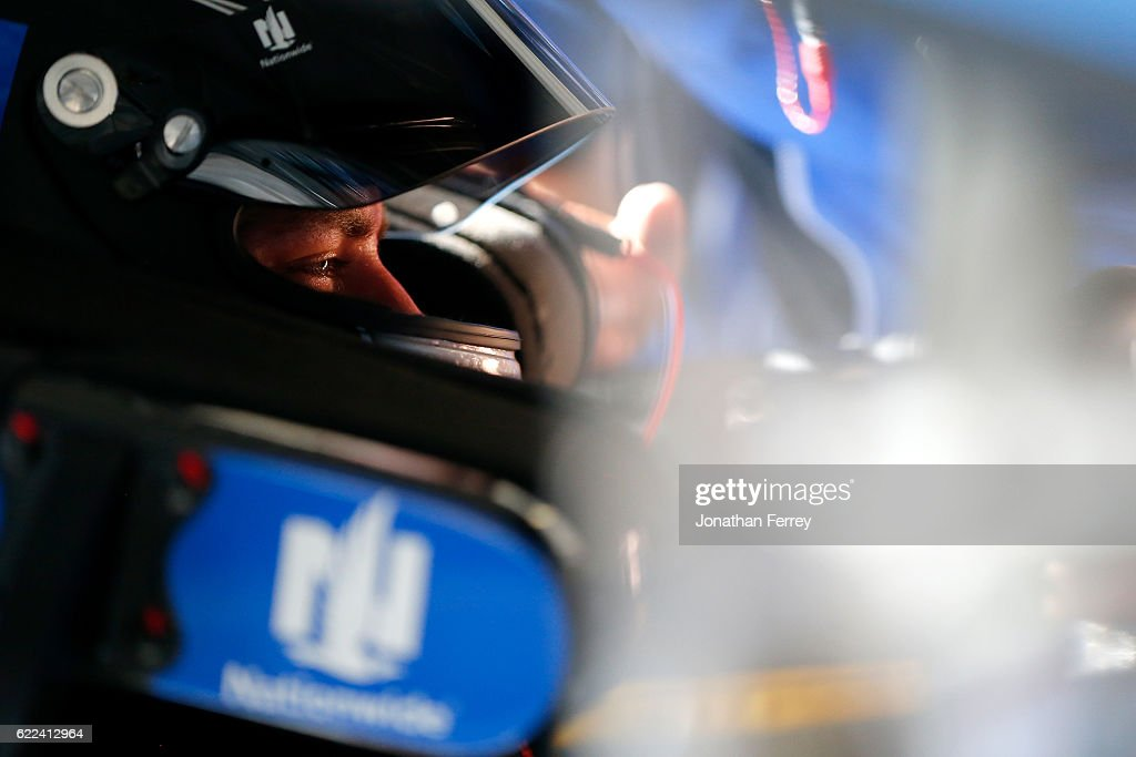 Alex Bowman, driver of the #88 Nationwide Chevrolet, sits in his car during practice for the NASCAR Sprint Cup Series Can-Am 500 at Phoenix International Raceway on November 11, 2016 in Avondale, Arizona.