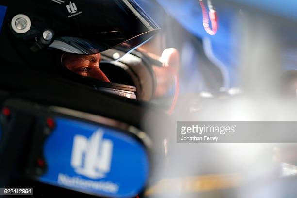 Alex Bowman driver of the Nationwide Chevrolet sits in his car during practice for the NASCAR Sprint Cup Series CanAm 500 at Phoenix International...