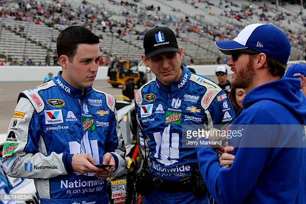 Alex Bowman driver of the Nationwide Chevrolet stands on the grid with crew chief Greg Ives and Dale Earnhardt Jr prior to the NASCAR Sprint Cup...