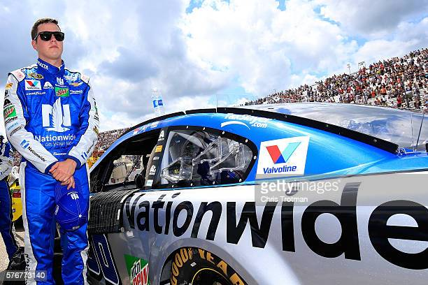 Alex Bowman driver of the Nationwide Chevrolet stands on the grid prior to the NASCAR Sprint Cup Series New Hampshire 301 at New Hampshire Motor...