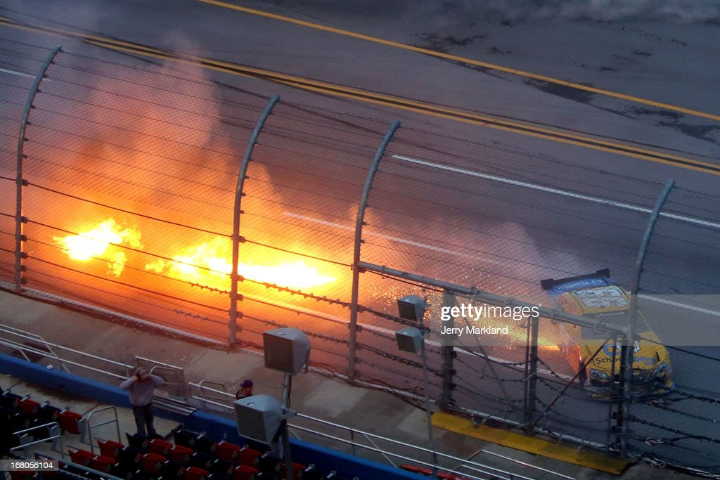 Alex Bowman driver of the SchoolTiplinecom Toyota has fire come out of his car as he wrecked during the NASCAR Nationwide Series Aaron's 312 at...