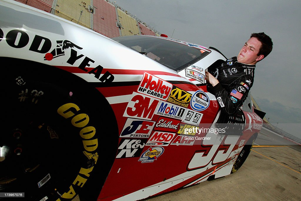 Alex Bowman, driver of the #99 St. Jude Children's Research Hospital Toyota, gets into his car during qualifying for the NASCAR Nationwide Series Alliance Truck Parts 250 at Michigan International Speedway on June 15, 2013 in Brooklyn, Michigan.