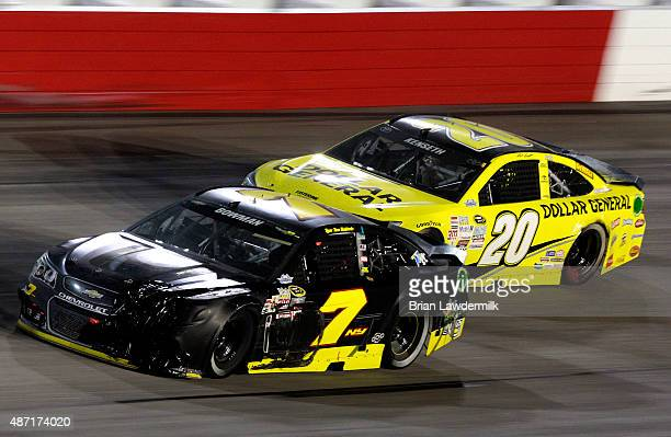 Alex Bowman driver of the Tommy Baldwin Racing Chevrolet leads Matt Kenseth driver of the Dollar General Toyota during the NASCAR Sprint Cup Series...