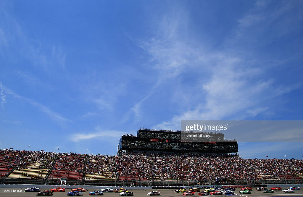Alex Bowman driver of the Vannoy Construction Chevrolet and Erik Jones driver of the Reser's Fine Foods Toyota lead the field to the green flag to...
