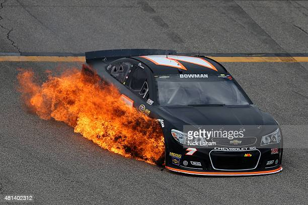 Alex Bowman drives the Tommy Baldwin Racing Chevrolet off of pit road as his car catches fire during the NASCAR Sprint Cup Series 5Hour ENERGY 301 at...