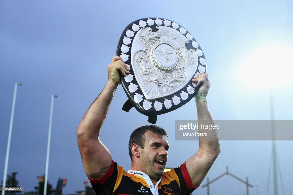 Alex Bradley of Waikato holds up the Ranfurly Shield after winning the ITM Cup round 15 rugby match between Waikato and Hawke's Bay at Waikato...