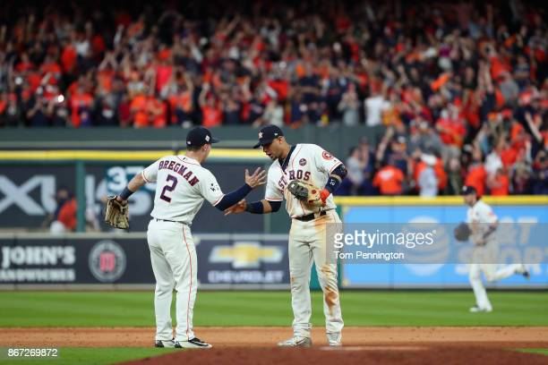 Alex Bregman and Yuli Gurriel of the Houston Astros celebrate after defeating the Los Angeles Dodgers in game three of the 2017 World Series at...