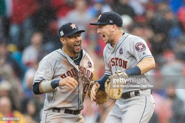 Alex Bregman and Yuli Gurriel of the Houston Astros react after recording the final out to clinch the series in game four of the American League...