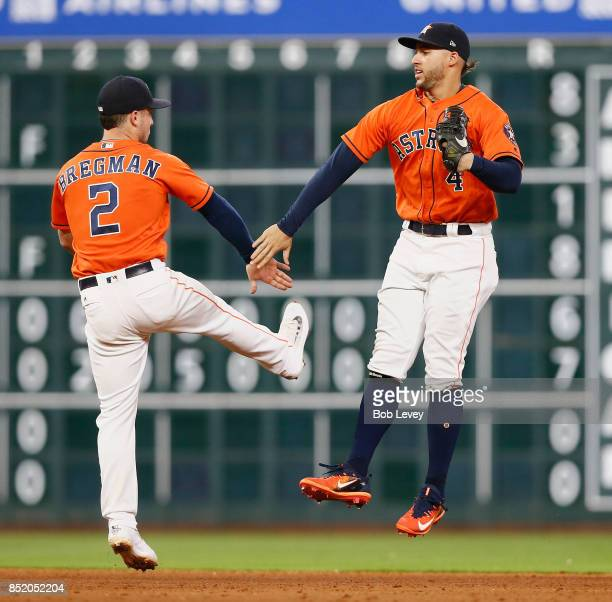 Alex Bregman of the Houston Astros and George Springer celebrate a 30 win over the Los Angeles Angels of Anaheim at Minute Maid Park on September 22...