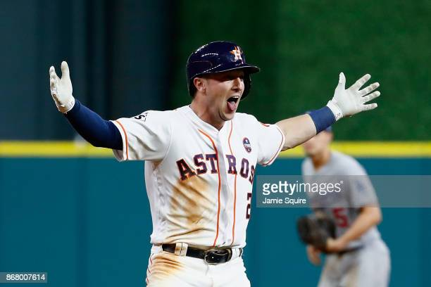Alex Bregman of the Houston Astros celebrates after hitting a gamewinning single during the tenth inning against the Los Angeles Dodgers in game five...