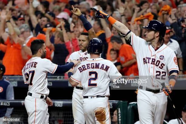 Alex Bregman of the Houston Astros celebrates with his teammates after scoring off of Brian McCann RBI double against the New York Yankees during the...