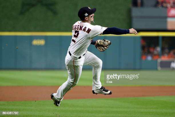 Alex Bregman of the Houston Astros fields a ball to first base hit by Gary Sanchez of the New York Yankees during the second inning in Game Six of...