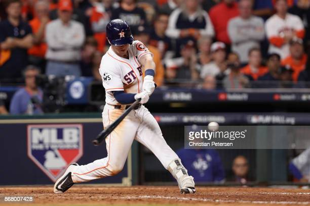 Alex Bregman of the Houston Astros hits a gamewinning single during the tenth inning against the Los Angeles Dodgers in game five of the 2017 World...