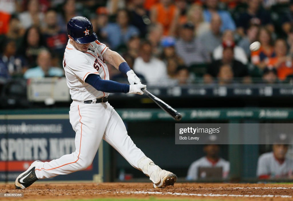 Alex Bregman #2 of the Houston Astros hits a three-run home run in the eighth inning against the Washington Nationals at Minute Maid Park on August 23, 2017 in Houston, Texas.
