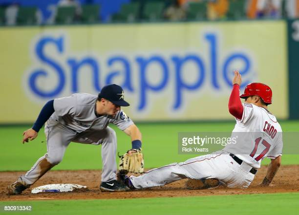 Alex Bregman of the Houston Astros misses the tag at second base in the fifth inning on ShinSoo Choo of the Texas Rangers at Globe Life Park in...