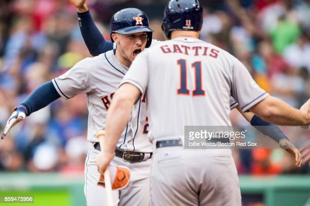 Alex Bregman of the Houston Astros reacts with Evan Gattis after hitting a game tying solo home run during the eighth inning of game four of the...