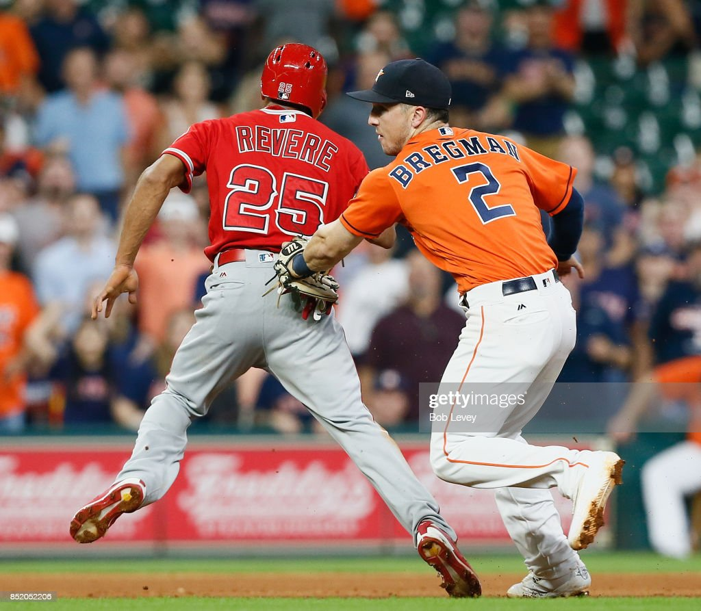 Alex Bregman #2 of the Houston Astros tags out Ben Revere #25 of the Los Angeles Angels of Anaheim in the ninth inning at Minute Maid Park on September 22, 2017 in Houston, Texas.