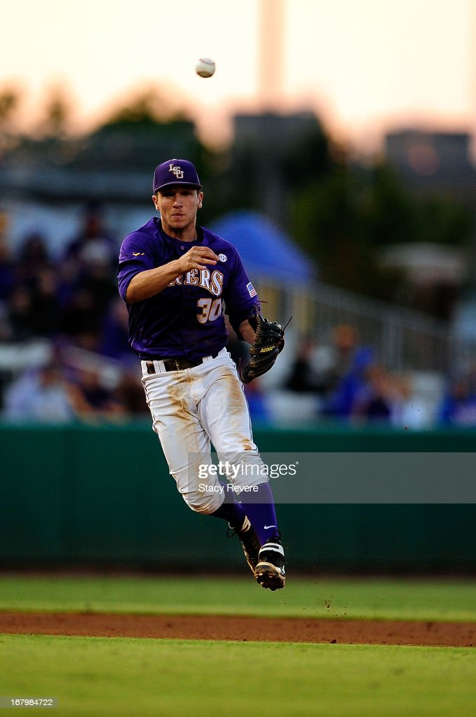 Alex Bregman #30 of the LSU Tigers makes a throw to first base during a game against the Florida Gators at Alex Box Stadium on May 3, 2013 in Baton Rouge, Louisiana.