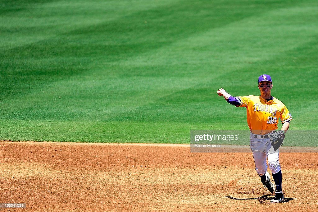 Alex Bregman #30 of the LSU Tigers throws to first base during a game against the Florida Gators at Alex Box Stadium on May 4, 2013 in Baton Rouge, Louisiana.