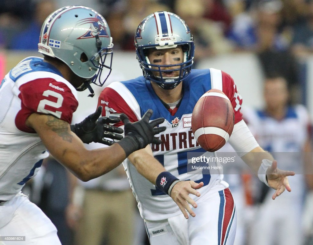 <a gi-track='captionPersonalityLinkClicked' href=/galleries/search?phrase=Alex+Brink&family=editorial&specificpeople=220457 ng-click='$event.stopPropagation()'>Alex Brink</a> #15 of the Montreal Alouettes passes the ball to Brandon Whitaker #2 in first quarter action in a CFL game against the Winnipeg Blue Bombers at Investors Group Field on August 22, 2014 in Winnipeg, Manitoba, Canada.