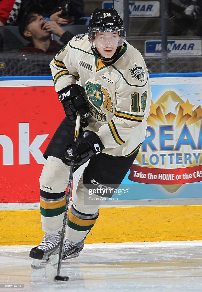 Alex Broadhurst #18 of the London Knights skates with the puck in an OHL game against the Mississauga Steelheads on December 9, 2012 at the Budweiser Gardens in London, Ontario, Canada. The Knights defeated the Steelheads 5-2 and tied their franchise record of 18 straight wins.