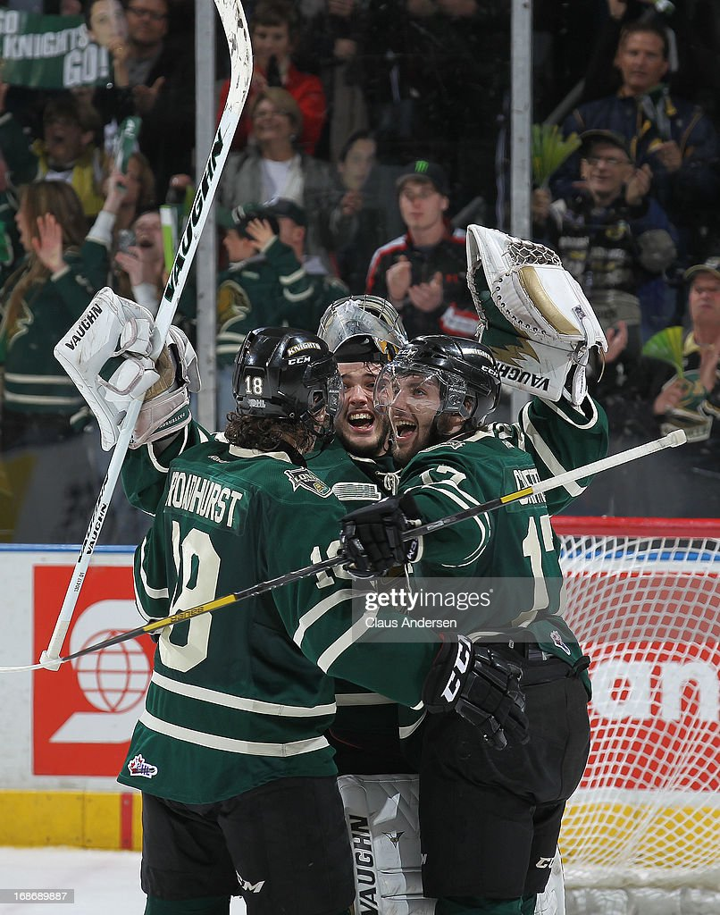 Alex Broadhurst #18, Seth Griffith #17, and Jake Patterson #35 of the London Knights celebrate after defeating the Barrie Colts in Game Seven of the 2013 OHL Championship Final on May 13, 2013 at the Budweiser Gardens in London, Ontario, Canada. The Knights defeated the Colts 3-2 to win the OHL Championship 4-3.