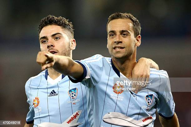 Alex Brosque and Christopher Naumoff of Sydney FC celebrate a goal during the round 26 ALeague match between the Newcastle Jets and the Sydney FC at...
