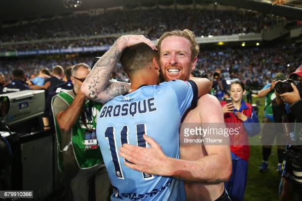 Alex Brosque and David Carney of Sydney celebrate at full time after Sydney FC win a penalty shoot out during the 2017 ALeague Grand Final match...