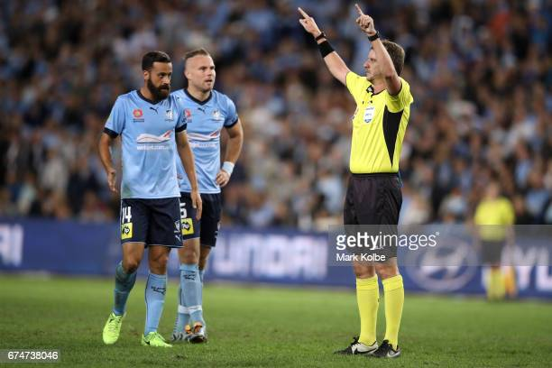 Alex Brosque and Jordy Buijs of Sydney FC watch on as referee Peter Green calls for a video referral for a goal decision during the ALeague Semi...