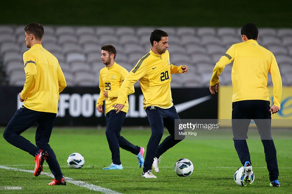 <a gi-track='captionPersonalityLinkClicked' href=/galleries/search?phrase=Alex+Brosque&family=editorial&specificpeople=235397 ng-click='$event.stopPropagation()'>Alex Brosque</a> controls the ball during an Australian Socceroos training session at WIN Jubilee Stadium on June 13, 2013 in Sydney, Australia.