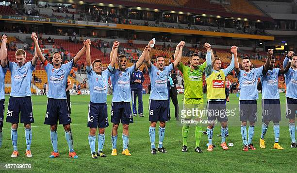 Alex Brosque of Sydney and team mates celebrate victory with fans after the round three ALeague match between Brisbane Roar and Sydney FC at Suncorp...