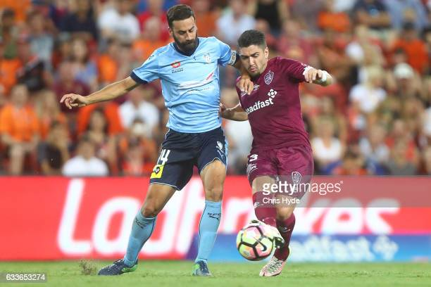Alex Brosque of Sydney FC and Dimitri Petratos of the Roar compete for the ball during the round 18 ALeague match between the Brisbane Roar and...