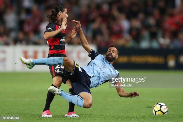 Alex Brosque of Sydney FC and Raul Llorente of the Wanderers compete for the ball during the round three ALeague match between Sydney FC and the...