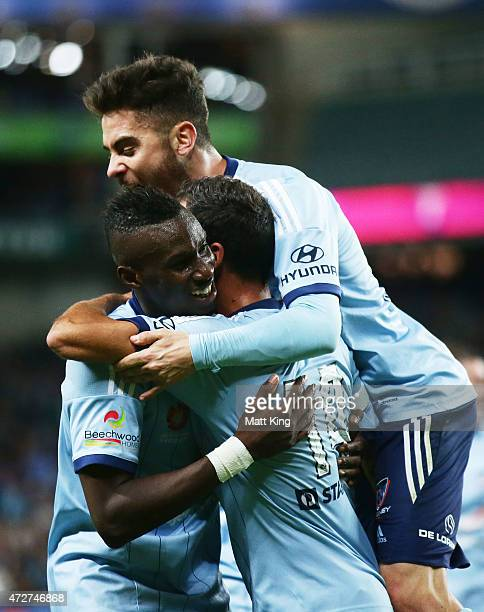 Alex Brosque of Sydney FC celebrates with Bernie IbiniIsei and Chris Naumoff after scoring the second goal during the ALeague Semi Final match...