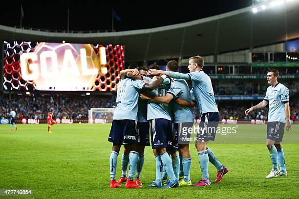 Alex Brosque of Sydney FC celebrates with team mates after scoring the second goal during the ALeague Semi Final match between Sydney FC and Adelaide...