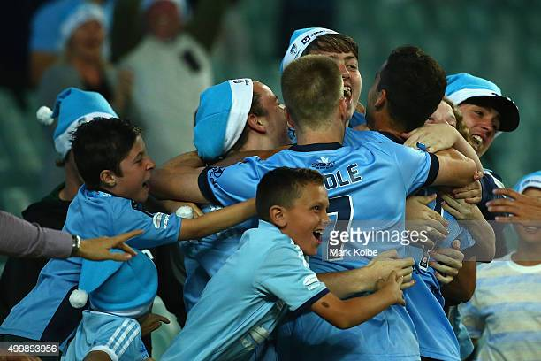 Alex Brosque of Sydney FC celebrates with the crowd after scoring a goal during the round nine ALeague match between Sydney FC and the Newcastle Jets...