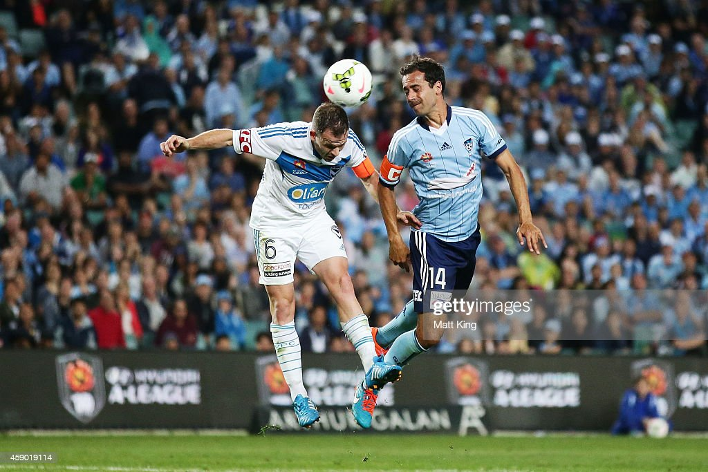 Alex Brosque of Sydney FC competes for the ball against Leigh Broxham of Melbourne Victory during the round six ALeague match between Sydney FC and...