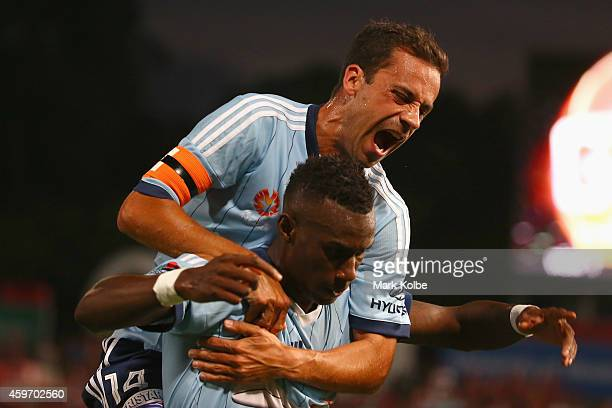 Alex Brosque of Sydney FC congratulates Bernie Ibini of Sydney FC as he celebrates scoring a goal during the round eight ALeague match between...