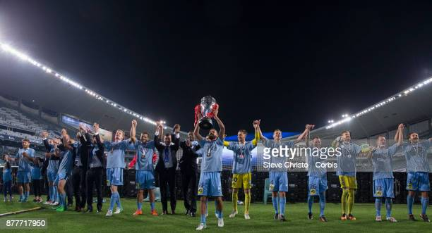 Alex Brosque of Sydney FC holds up the FFA Cup in front of the Cove during the FFA Cup Final match between Sydney FC and Adelaide United at Allianz...