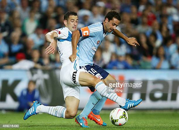Alex Brosque of Sydney FC is challenged by Carl Valeri of Melbourne Victory during the round six ALeague match between Sydney FC and Melbourne...