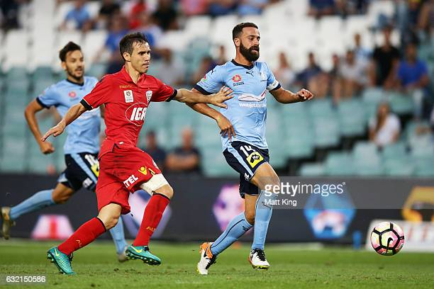Alex Brosque of Sydney FC is challenged by Isaias of United during the round 16 ALeague match between Sydney FC and Adelaide United at Allianz...