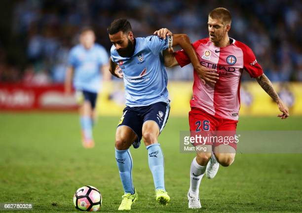 Alex Brosque of Sydney FC is challenged by Luke Brattan of Melbourne City during the round 25 ALeague match between Sydney FC and Melbourne City FC...