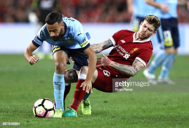 Alex Brosque of Sydney FC is tacked by Alberto Moreno of Liverpool during the International Friendly match between Sydney FC and Liverpool FC at ANZ...