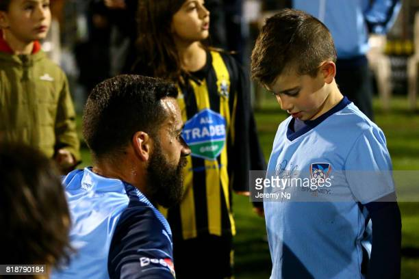 Alex Brosque of Sydney FC signs on a young fan's shirt during the 2017 Johnny Warren Challenge match between Sydney FC and Earlwood Wanderers at...