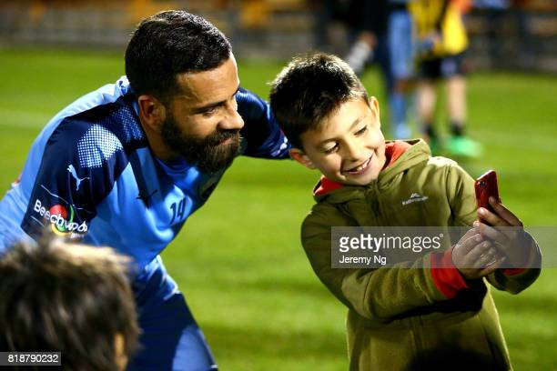 Alex Brosque of Sydney FC takes a photo with a young fan after the 2017 Johnny Warren Challenge match between Sydney FC and Earlwood Wanderers at...