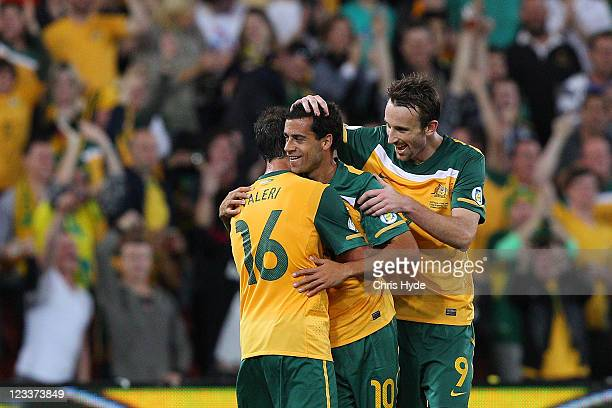 Alex Brosque of the Socceroos celebrates a goal with teamates Carl Valeri and Josh Kennedy during the Asian Qualifying 2014 FIFA World Cup match...