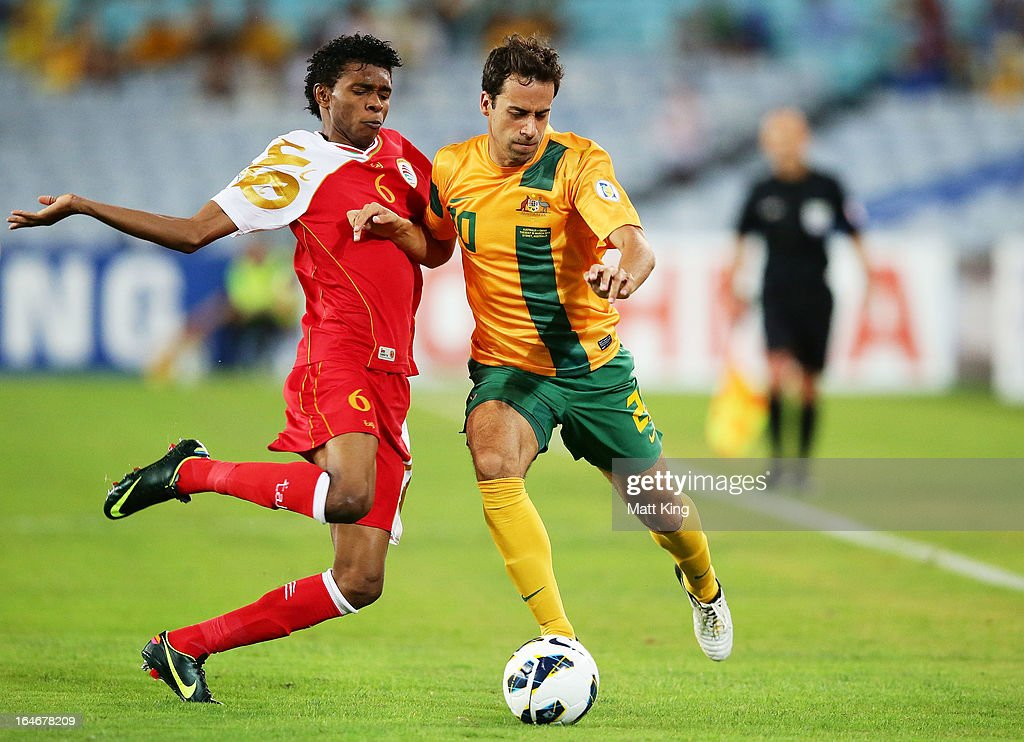 Alex Brosque of the Socceroos is challenged by Raed Saleh of Oman during the FIFA 2014 World Cup Qualifier match between the Australian Socceroos and Oman at ANZ Stadium on March 26, 2013 in Sydney, Australia.