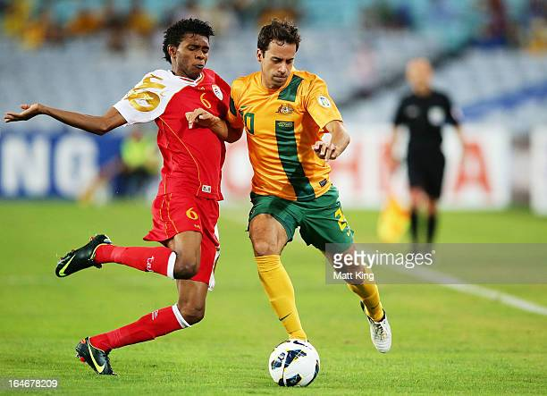 Alex Brosque of the Socceroos is challenged by Raed Saleh of Oman during the FIFA 2014 World Cup Qualifier match between the Australian Socceroos and...